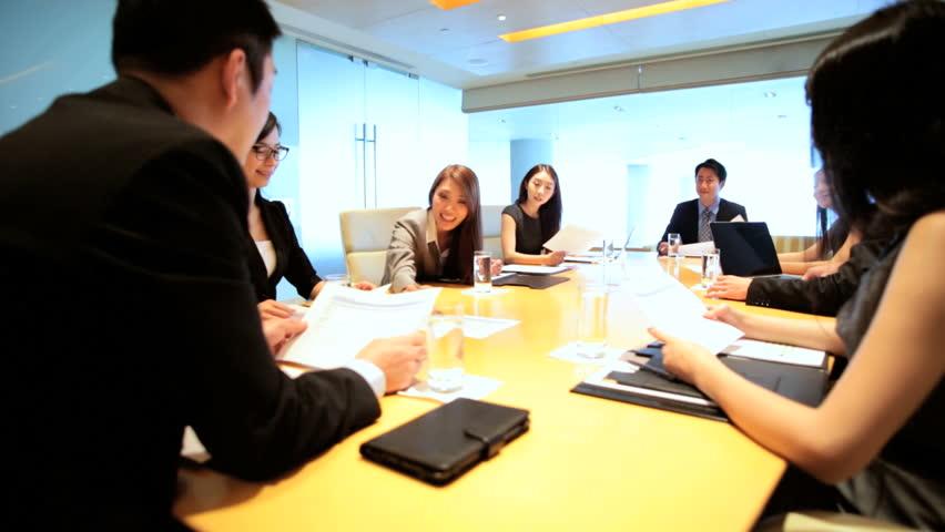 Boardroom conference meeting teamwork ethnic executive management planning business businessman businesswomen wireless laptop computer | Shutterstock HD Video #7852180