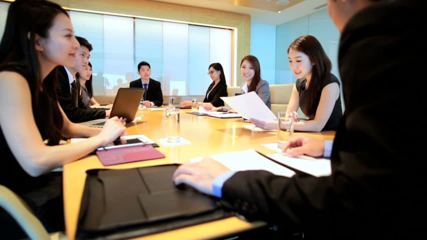 Asian Chinese male female business executives consultants city boardroom meeting teamwork communication conference wireless device | Shutterstock HD Video #7852252