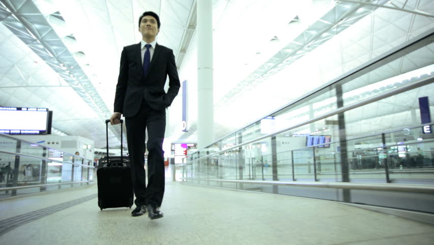 Asian Chinese young male city airport business travel passenger luggage career global executive suit meeting conference | Shutterstock HD Video #7854232