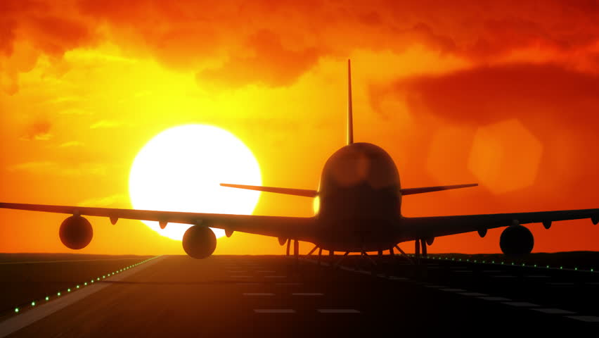 Jet plane departs from airport runway as silhouette in front of large sunset / sunrise 4K UltraHD | Shutterstock HD Video #7859380