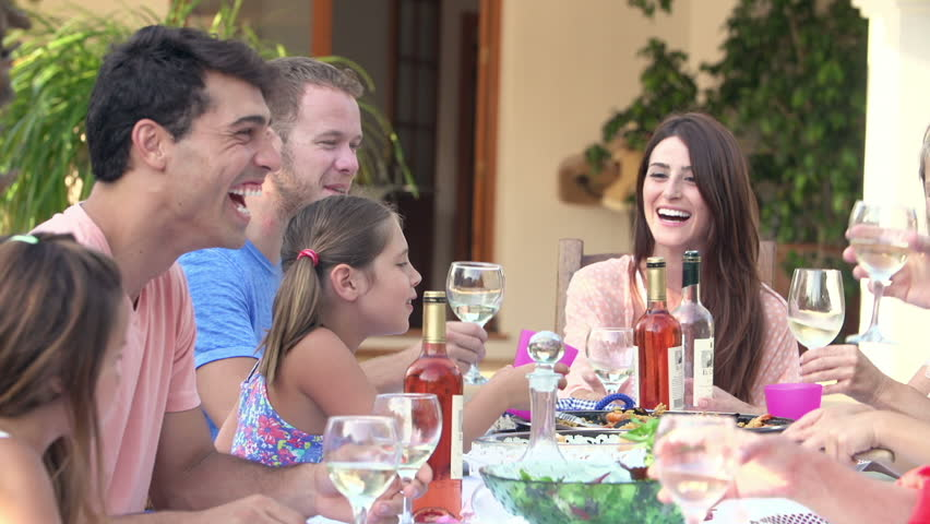 Dinner Party Video Part - 25: Large Family Group Eating Meal And Drinking Wine At Table On Outdoor  Terrace. Shot On