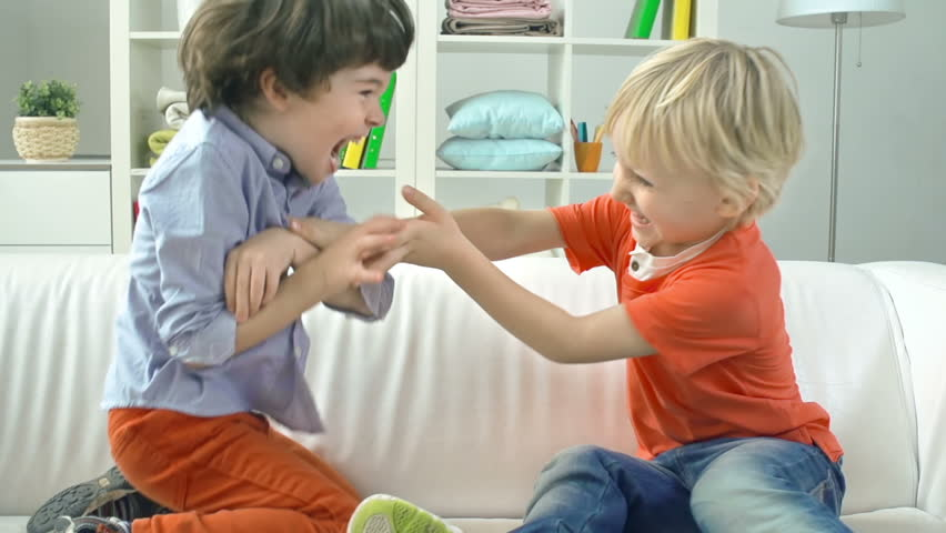 Close up of two little boys fighting in joyous game | Shutterstock HD Video #7920430