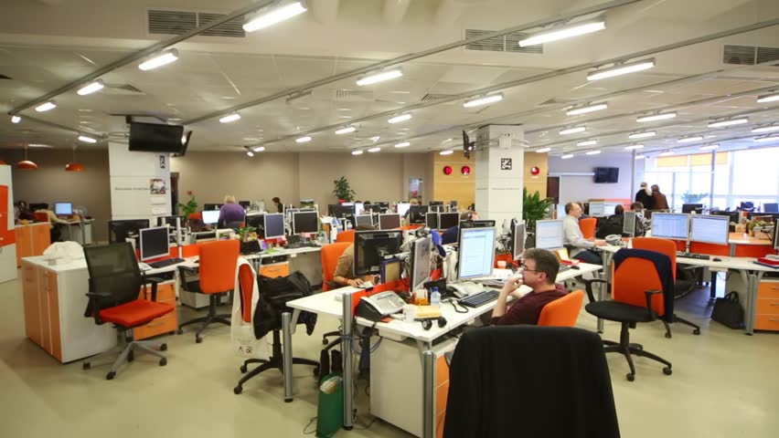 MOSCOW, RUSSIA - MAR 5, 2013: People at computers in office of RIA Novosti russian news agency