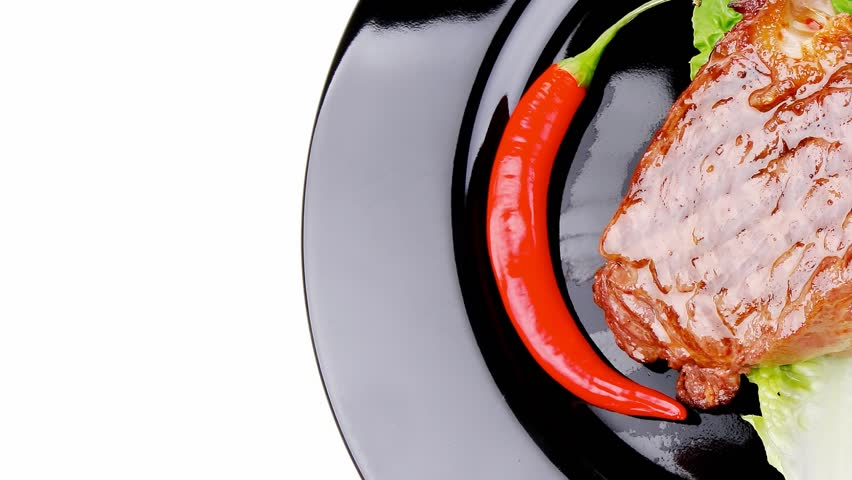 meat food : roast beef garnished with green lettuce and red chili hot pepper on black dish 1920x1080 intro motion slow hidef hd