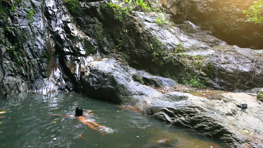 Beautiful Woman Enjoying Bathing Near Natural Waterfall On ...