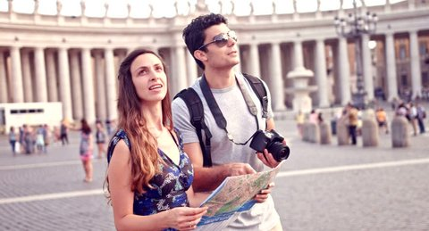Young Tourists Exploring Rome Map Vacation Concept Taking Pictures