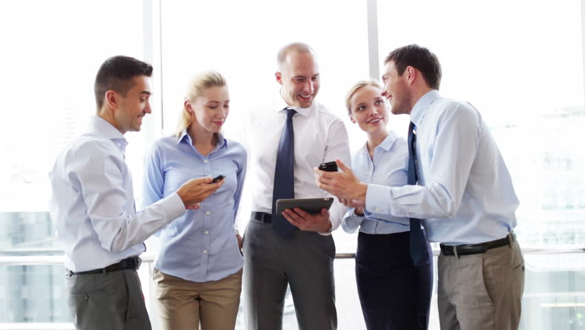 Business, teamwork, people and technology concept - business team with tablet pc and smartphones meeting in office | Shutterstock HD Video #7982200