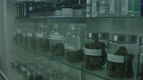 """MEDICAL MARIJUANA CONTAINERS ON DISPLAY INSIDE A MEDICAL MARIJUANA DISPENSARY. ALL LABEL ARTWORK CREATED & CLEARED BY """"PROP HEAVEN"""" IN BURBANK, CALIFORNIA."""