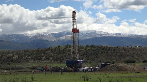 MORONI, UTAH - OCT 2014: Oil drilling rig rural farm land. With gas and oil pricing at near record price exploration continues to new areas never before explored.