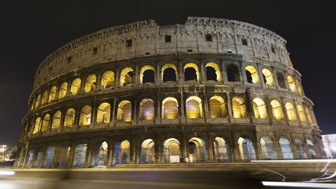 4K Time lapse of traffic in front of the majestic colosseum Amphitheater, Rome, Italy.