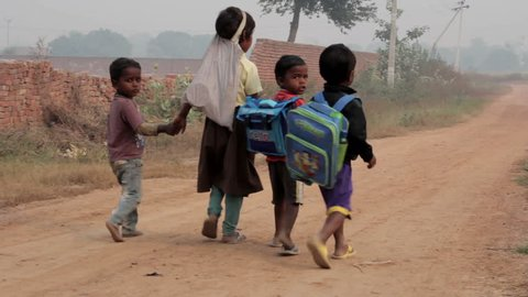 Indian children are on a rural road