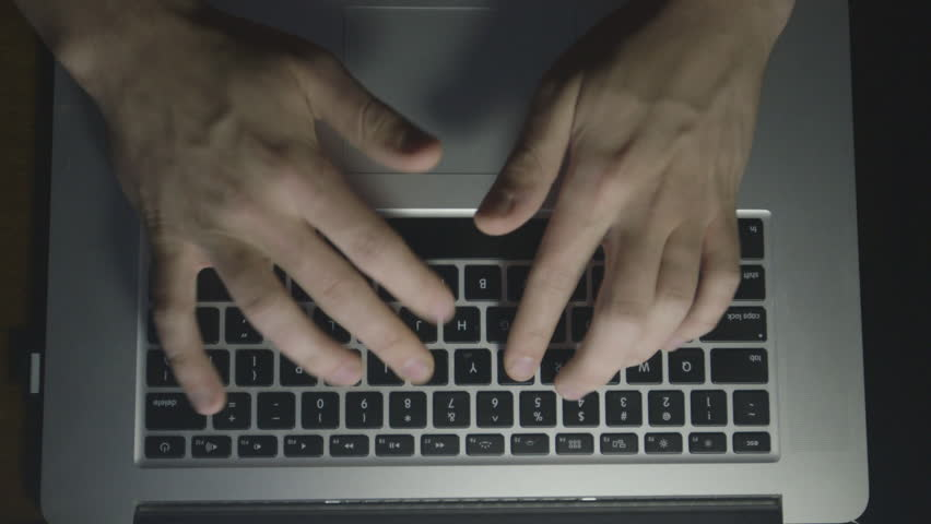 an above shot of a hands getting frustrated at a computer