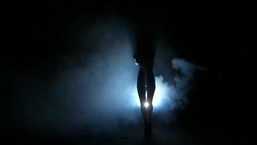 One Sexy Woman Stripper Showgirl In Silhouette Studio