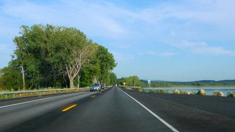 Driving On U.S. Highway 2 North In Rural Vermont Passing Through Lake Champlain From Rouses Point New York.
