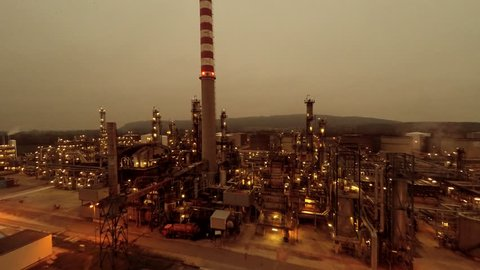 flying over oil gas refinery factory at night. energy gasoline industry background