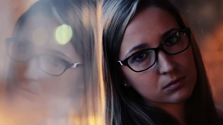 Portrait of sad, beautiful woman standing by the window   | Shutterstock HD Video #8153707