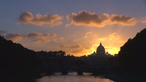 Timelapse of sunset, sky with cloud pass over St Peters church dome in Rome, water reflection in twilight