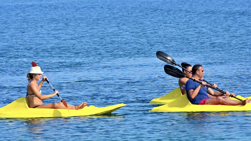 Young people having fun at sea kayaking