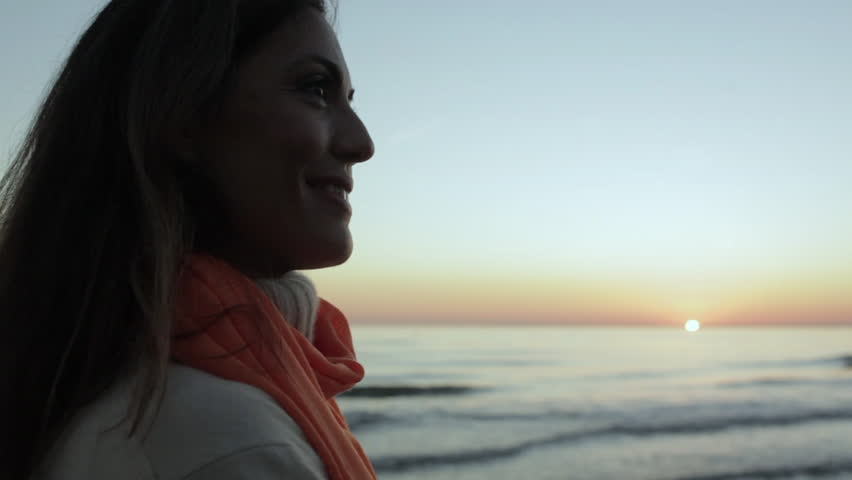 Woman Looking At Ocean In Sunset. #8186410