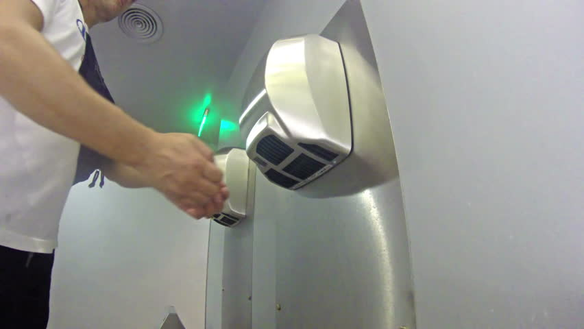 4k Drying off hands at toilet hand drier