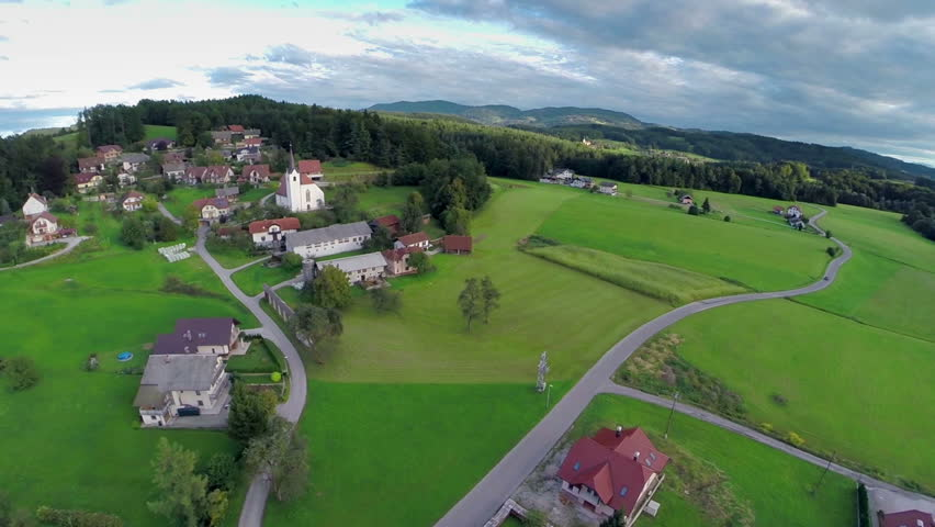 CELJE, SLOVENIA - SEPTEMBER 2014: Small village in a nature near forest. Small village near forest in a nature, aerial fly over shoot | Shutterstock HD Video #8275210