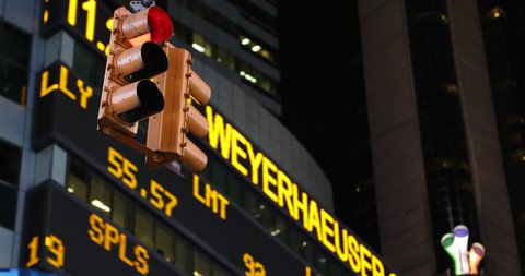NEW YORK CITY, USA - APRIL 23, 2013 Red Green Car Traffic Light Illuminated Night Stock Market Ticker NYC Financial, Nasdaq Board ( Ultra High Definition, Ultra HD, UHD, 4K, 2160P, 4096x2160 )