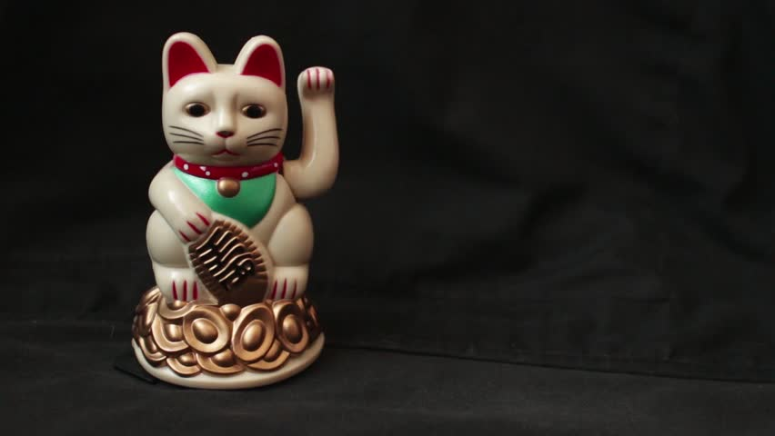 """LUCKY ASIAN WAVING CAT -  30fps normal speed waving cat on camera left; dolly left off screen, then return to settle.  // Maneki-neko """"Beckoning Cat"""", popular in Asia as a symbol of luck and wealth. 