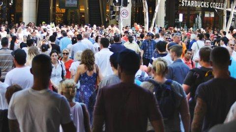 Crowds cross road at G20 in Brisbane. BRISBANE, AUSTRALIA - CIRCA NOVEMBER 2014: Brisbane played host to the G20 Summit.