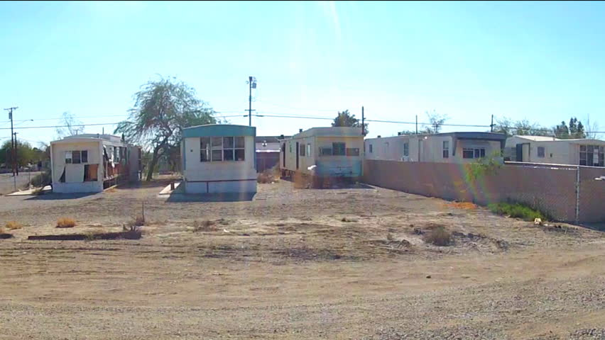 NILAND CA December 16 2014 Shot Of Driving By Mobile Homes In A Small Desert Town Circa Niland Rural Community Features Neighborhoods Filled