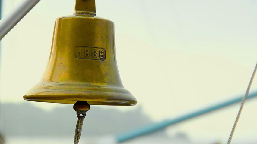 Vintage beautiful ship bell with rope, boat gong, nautical décor. Alarm signal on marine vessel. Voyage in search for adventures. Sophisticated antique copper handbell ringing on board of luxury yacht
