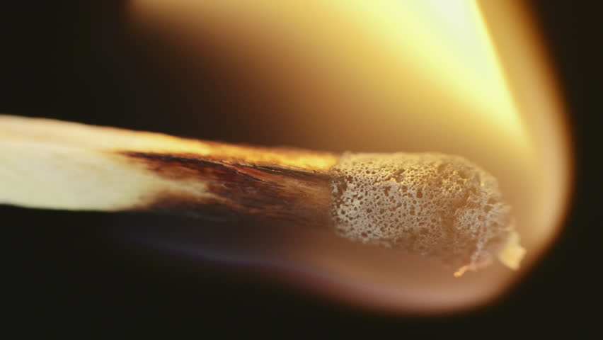 Match inginiting burning extreme macro close up background.