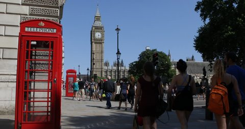 LONDON, ENGLAND - AUGUST 15, 2013 Red Phonebox People Walk Commute near Parliament Square Westminster Palace London ( Ultra High Definition, UltraHD, Ultra HD, UHD, 4K, 2160P, 4096x2160 )
