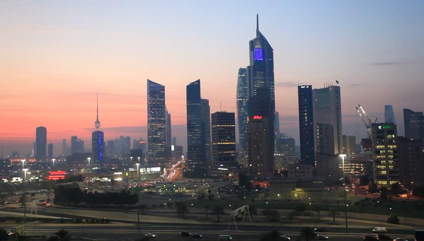 KUWAIT - DECEMBER 10: Skyline of Kuwait City illuminated at dusk. December 10, 2014 in Kuwait, Middle East