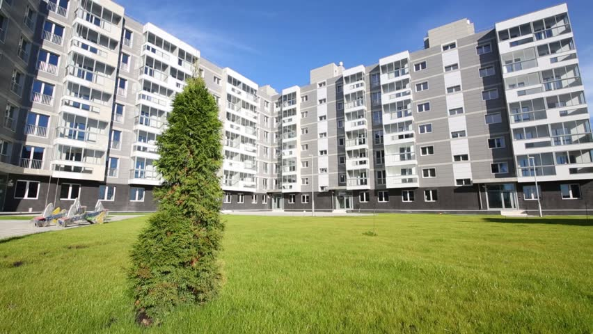 Sixstory Apartment Building In Residential Complex And Tree