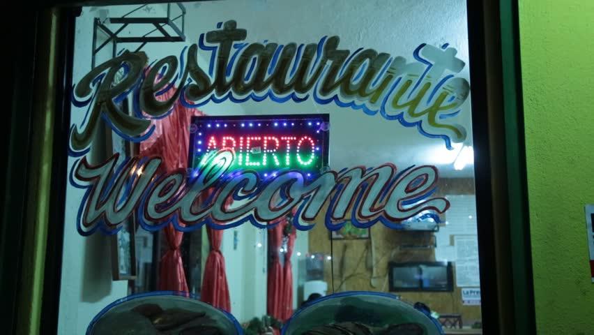 """Neon Open """"Abierto"""" Sign in Restaurant Window"""