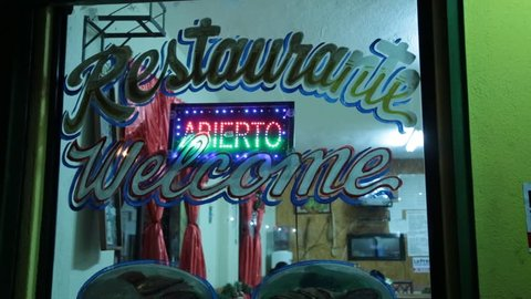 "Neon Open ""Abierto"" Sign in Restaurant Window"