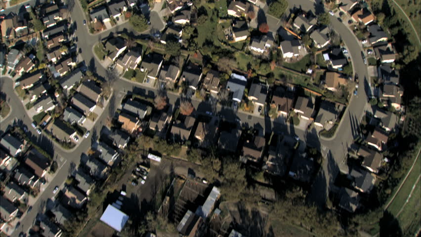 Aerial view of rooftops of housing in city suburbs (slightly shaky)