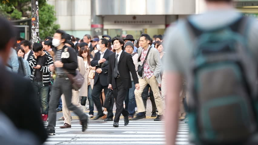 TOKYO, JAPAN - CIRCA 2013: Large crowds of pedestrians, commuters, and shoppers cross the famous Shibuya intersection  #8483950