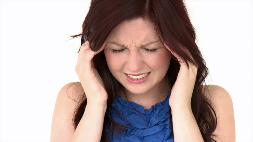 Positive girl having a headache against a white background - HD stock  footage clip
