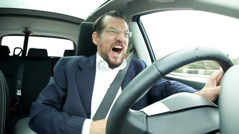Business man driving car feeling stomach sick funny faces