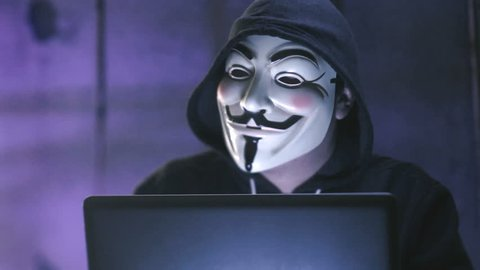 NEW YORK - JAN 19: Anonymous computer hacker wearing Guy Fawkes vendetta mask on January 19, 2015.