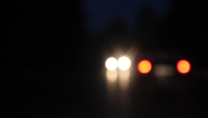 video light bokeh car headlights from moving car