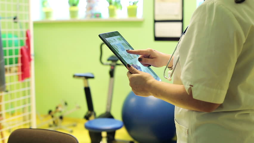 Doctor`s hands working with tablet in the office    Shutterstock HD Video #8602060