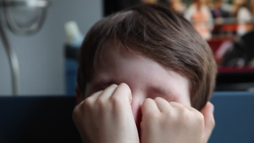 Kid rubs his eyes, boy with allergy rubbing his face, allergic child