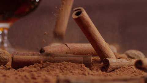 Cinnamon falling Into cacao. Spices. Slow motion. With  brandy.