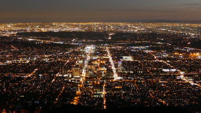 Dusk to night time lapse view of Glendale and downtown Los Angeles, California.