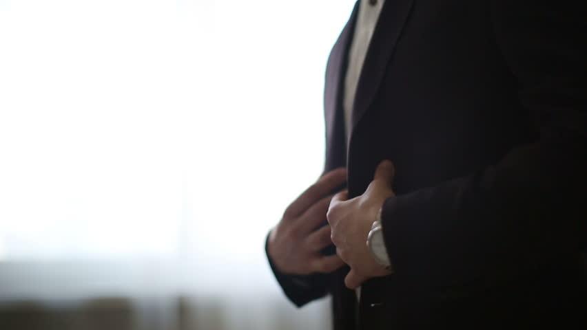 Man putting on a jacket | Shutterstock HD Video #8667649