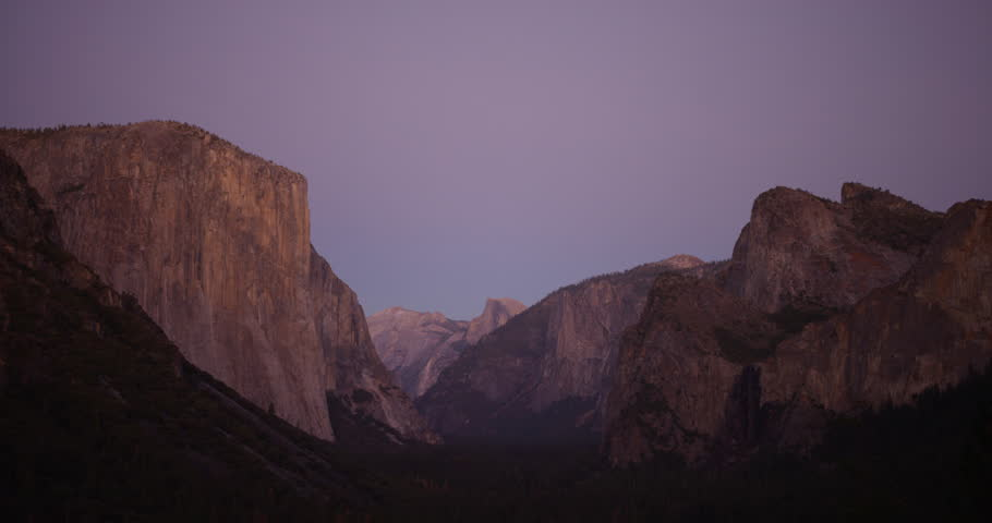 Yosemite Valley can be seen from tunnel viewpoint during sunset. Yosemite National Park, California is visited by over 3.7 million tourists yearly. Shot on Red Epic.