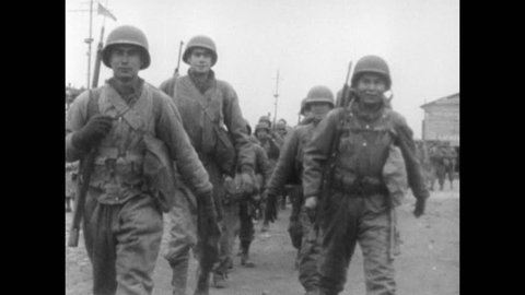 Soldiers of the US 36th Infantry Division walk towards Velletri to take part in Operation Diadem during the Italian Campaign of World War II, circa May 1944