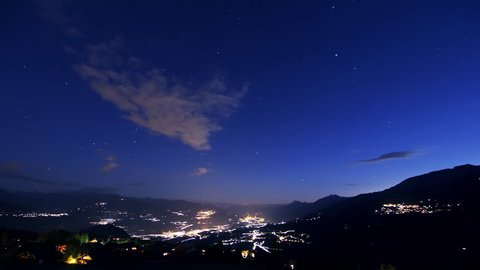 Switzerland by night Timelapse / Night Falling over Switzerland, beautiful valley with lights moving. View from the mountain  Crans-Montana - European Alps